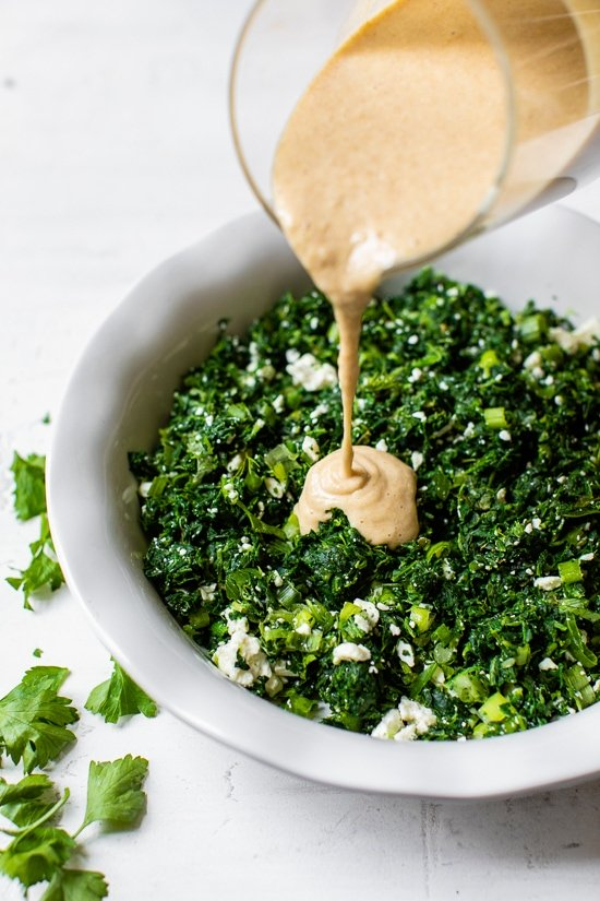 pouring batter onto spinach